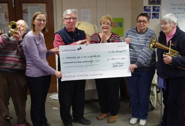 Brass band hands over cheque to therapeutic nursery